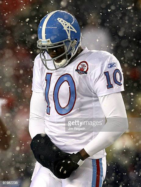 Vince Young of the Tennessee Titans leaves the field in the fourth quarter during a game against the New England Patriots converse at Gillette...