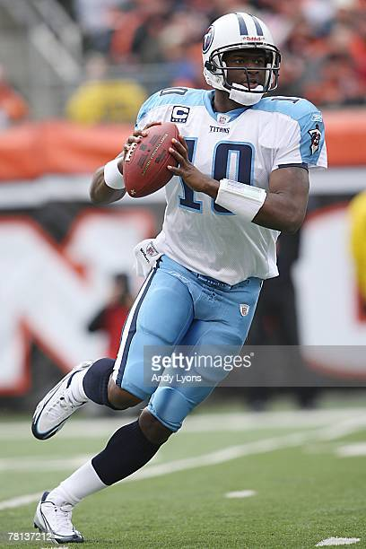 Vince Young of the Tennessee Titans looks to pass during the NFL game against the Cincinnati Bengals at Paul Brown Stadium on November 25 2007 in...