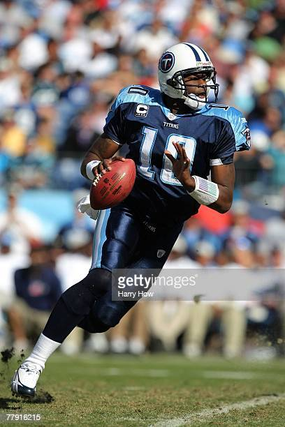Vince Young of the Tennessee Titans moves to pass the ball during the game against the Carolina Panthers at LP Field on November 4, 2007 in...
