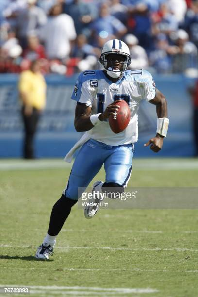 Vince Young of the Tennessee Titans runs for a first down in the fourth quarter during a game against the Indianapolis Colts at LP Field September 16...
