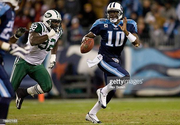 Vince Young of the Tennessee Titans scrambles as he is forced out of the pocket by Shaun Ellis of the New York Jets at LP Field on December 23 2007...