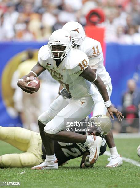 Vince Young of the Texas Longhorns attempts to elude defenders versus the Colorado Buffalos in the Big 12 Championship at Reliant Stadium in Houston,...