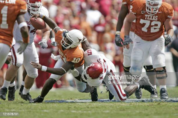 Vince Young of the Texas Longhorns dives for extra yards against the Oklahoma Sooners in the 100th annual Red River Rivalry at the Cotton Bowl in...