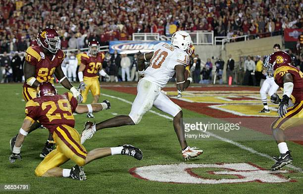 Vince Young of the Texas Longhorns rushes past Frostee Rucker Scott Ware and Josh Pinkard of the USC Trojans to score a 2 point conversion following...
