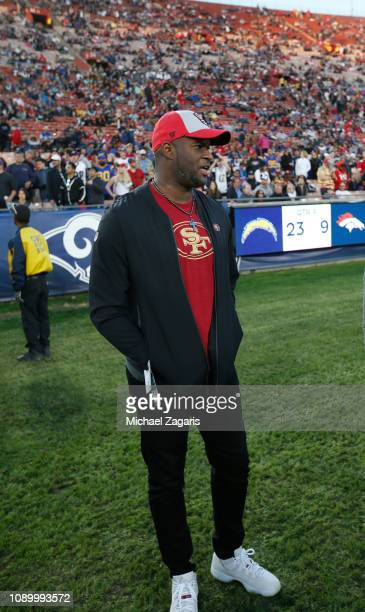Vince Young stands on the sideline during the game between the San Francisco 49ers and the Los Angeles Rams at the LA Memorial Coliseum on December...