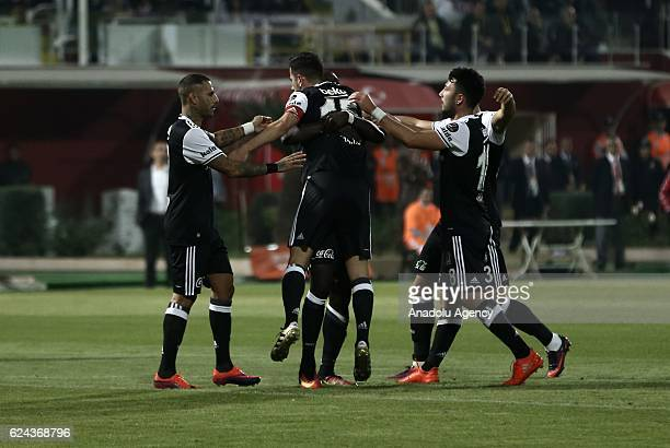 Vincent Aboubakar of Besiktas celebrates after scoring a goal with his team mates during the Turkish Spor Toto Super Lig match between Adanaspor and...