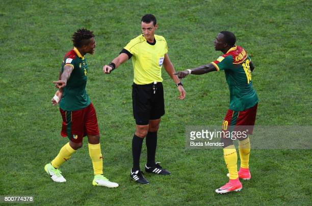 Vincent Aboubakar of Cameroon and Adolphe Teikeu of Cameroon argue with referee Wilmar Roldan during the FIFA Confederations Cup Russia 2017 Group B...