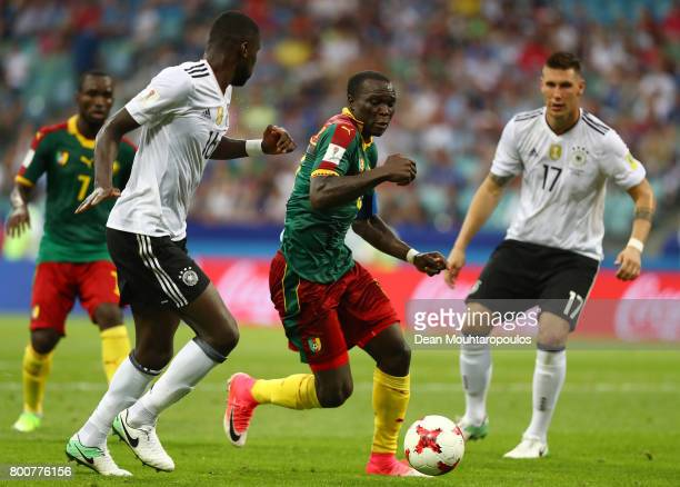 Vincent Aboubakar of Cameroon attempts to take the ball past Niklas Suele of Germany during the FIFA Confederations Cup Russia 2017 Group B match...