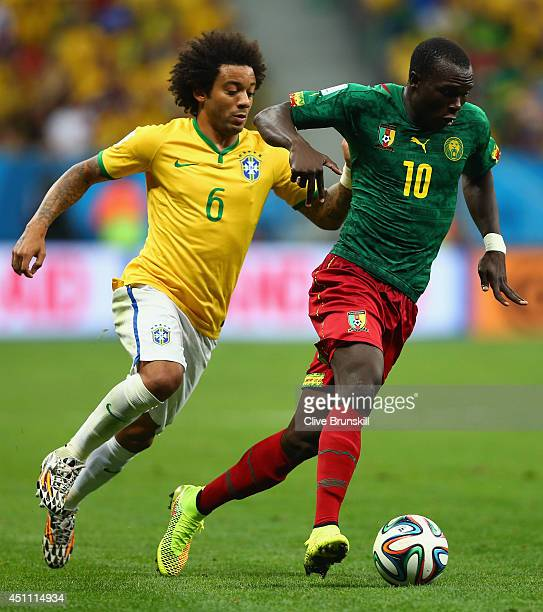 Vincent Aboubakar of Cameroon controls the ball against Marcelo of Brazil during the 2014 FIFA World Cup Brazil Group A match between Cameroon and...