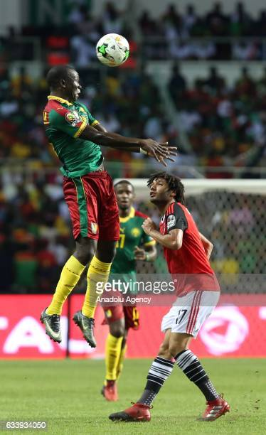 Vincent Aboubakar of Cameroon in action against Arnaud Sutchuin Djoum of Egypt during the 2017 Africa Cup of Nations final football match between...