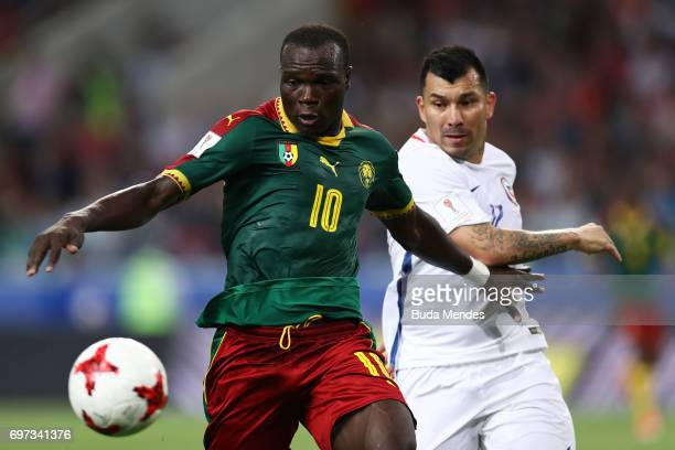 Vincent Aboubakar of Cameroon is put under pressure from Gary Medel of Chile during the FIFA Confederations Cup Russia 2017 Group B match between...