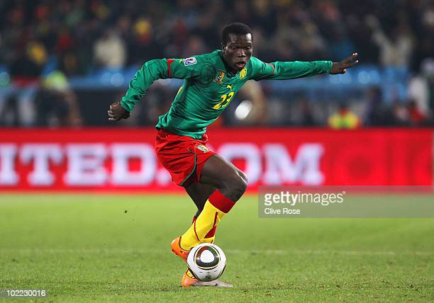 Vincent Aboubakar of Cameroon runs with the ball during the 2010 FIFA World Cup South Africa Group E match between Cameroon and Denmark at Loftus...