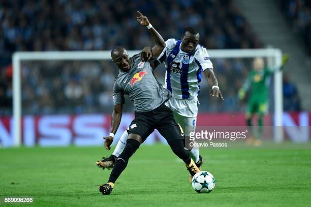 Vincent Aboubakar of FC Porto competes for the ball with Naby Keita of RB Leipzig during the UEFA Champions League group G match between FC Porto and...