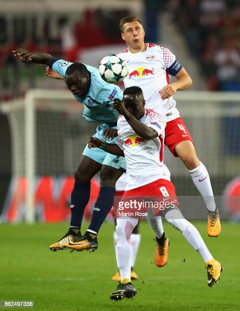 Vincent Aboubakar of FC Porto Naby Keita of RB Leipzig and Willi Orban of RB Leipzig battle for posession during the UEFA Champions League group G...