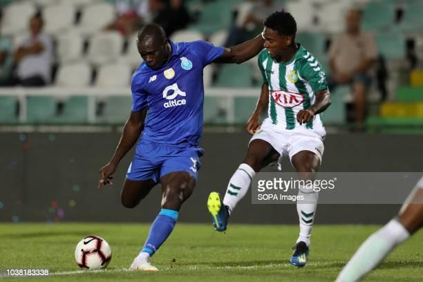 Vincent Aboubakar of FC Porto vies for the ball with Mano of V Setubal during League NOS 2018/19 football match between V Setubal vs FC Porto
