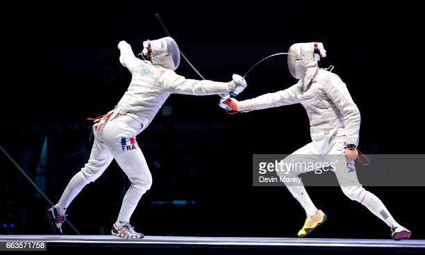 Vincent Anstett of France fences Junghwan Kim of South Korea in the men's gold medal match during competition at the SK Telecom Seoul Sabre Grand...