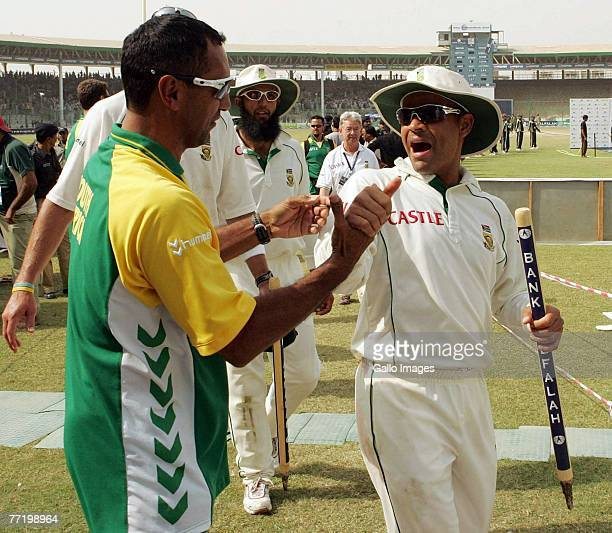 Vincent Barnes celebrates with Ashwell Prince during day five of the first test match series between Pakistan and South Africa held at the National...