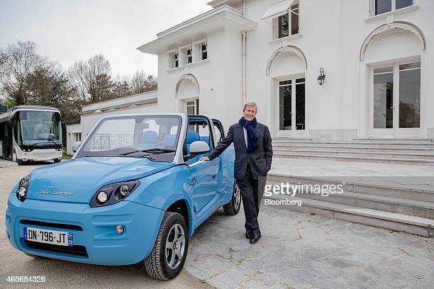 Vincent Bollore billionaire and chairman of the Bollore Group poses with a Blue Summer car at the Autolib' carsharing headquarters in Vaucresson...