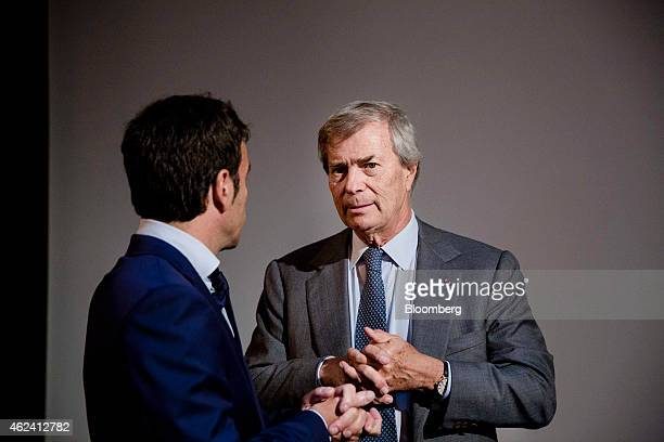 Vincent Bollore billionaire and chairman of the Bollore Group right attends an Autolib carsharing scheme news conference in Paris France on Wednesday...