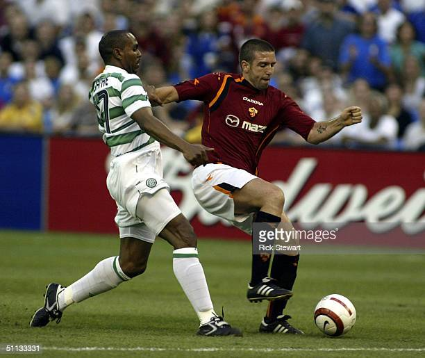 Vincent Candela of AS Roma figths for position against Didier Agathe of Celtic during their Championsworld Series match on July 31 2004 at Skydome in...