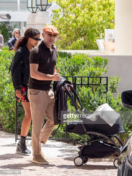 Vincent Cassel and Tina Kunakey are seen during the 72nd annual Cannes Film Festival at the Martinez Hotel on May 16 2019 in Cannes France