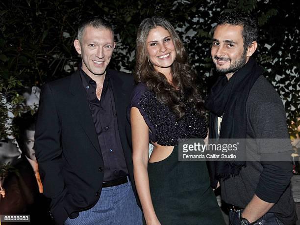Vincent Cassel Sabrina Gasperin and FrancoisXavier Schultz attend the party of the Yves Saint Laurent fragrance La Nuit de L'Homme on June 20 2009 in...