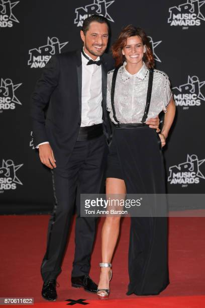 Vincent Cerutti and Fauve Hautot arrive at the 19th NRJ Music Awards ceremony at the Palais des Festivals on November 4 2017 in Cannes France