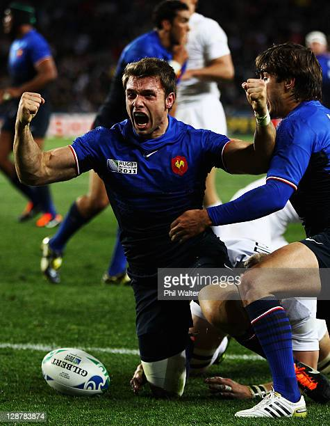 Vincent Clerc of France celebrates his opening try with Alexis Palisson during quarter final two of the 2011 IRB Rugby World Cup between England and...