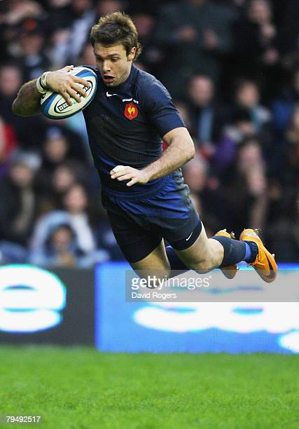 Vincent Clerc of France dives over to score his team's third try during the RBS Six Nations Championship match between Scotland and France at...
