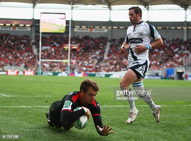 Vincent Clerc of Toulouse scores his sides third try as Nick Macleod of Sale fails to challenge during the Heineken Cup Pool Five match between...