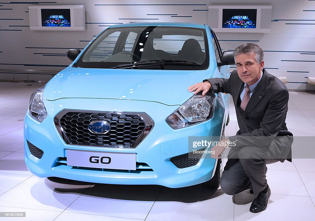 Vincent Cobee, global head for the Datsun brand at Nissan Motor Co., poses for a photograph with a Datsun Go automobile at the company's showroom in Yokohama, Japan on Wednesday, Jan. 8, 2014. Nissan said its low-end Datsun business will generate operating margins of as high as 7 percent because of its no-frills designs and by sharing the parents development facilities and distribution network. Photographer: Yuriko Nakao/Bloomberg via Getty Images