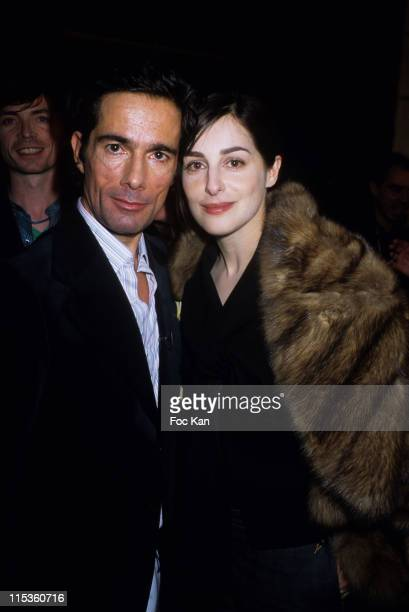 Vincent Darre and Amira Casar during Paris Fashion Week Ready To Wear Fall/Winter 2005 Ungaro Show at Front Row Carrousel Du Louvre in Paris France