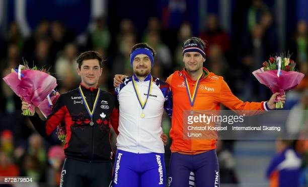 Vincent de Haitre of Canada poses during the medal ceremony after winning the 2nd place Thomas Krol of the Netherlands poses during the medal...