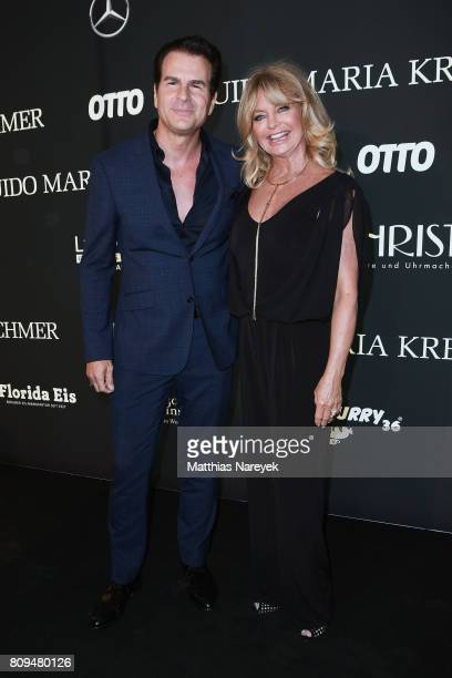 Vincent De Paul and Goldie Hawn attend the Guido Maria Kretschmer Fashion Show Autumn/Winter 2017 at Tempodrom on July 5 2017 in Berlin Germany