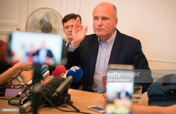 Vincent Debraize, mayor of Champignolles, a small village in Normandy in northern France, speaks during a press conference on June 22, 2017 in Paris...