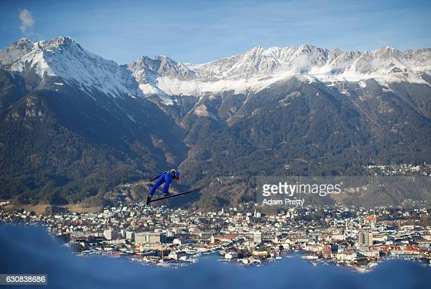 Vincent Descombes Sevoie of France soars through the air during his qualification jump on Day 1 of the 65th Four Hills Tournament ski jumping event...
