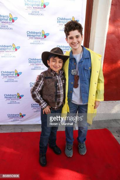 Vincent Dominguez and Jax Malcolm attend the 2nd Annual #ActionJax Halloween Movie Morning Fundraiser at the Vista Theatre on October 7 2017 in Los...