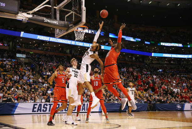Vincent Edwards of the Purdue Boilermakers battles for a rebound with Norense Odiase of the Texas Tech Red Raiders during the second half in the 2018...