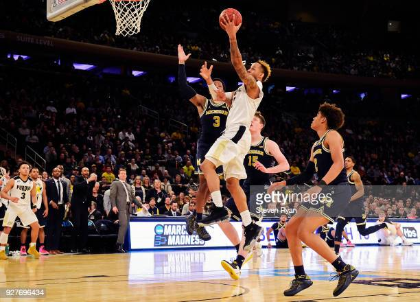 Vincent Edwards of the Purdue Boilermakers drives to the basket against the Michigan Wolverines during the championship game of the Big Ten...