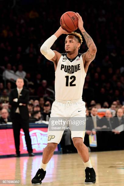 Vincent Edwards of the Purdue Boilermakers shoots against the Michigan Wolverines during the championship game of the Big Ten Basketball Tournament...