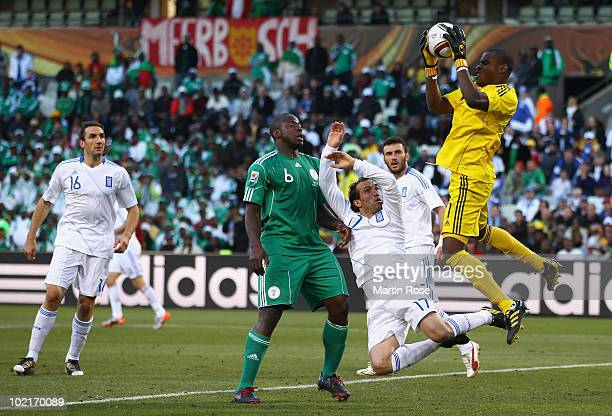 Vincent Enyeama of Nigeria catches the ball ahead of Theofanis Gekas of Greece during the 2010 FIFA World Cup South Africa Group B match between...