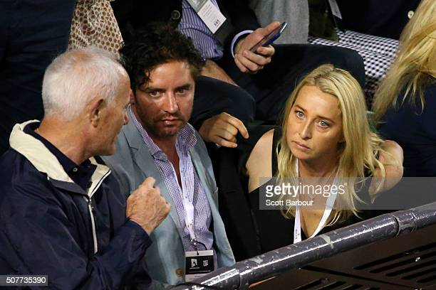 Vincent Fantauzzo and Asher Keddie watch the Men's Singles Final match between Andy Murray of Great Britain and Novak Djokovic of Serbia during day...
