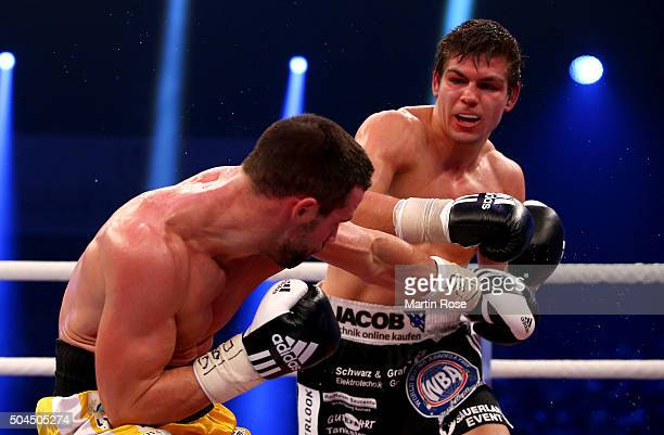 Vincent Feigenbutz of Germany exchange punches with Giovanni De Carolis of Italy during the WBA SuperMiddleweight championship title fight at Baden...