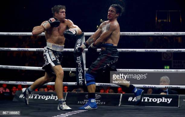 Vincent Feigenbutz of Germany exchanges punches with Gaston Alejandro of Argentina during their WBSS Super Middleweight Substitute fight on October...