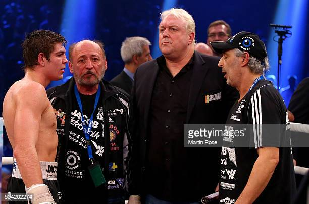 Vincent Feigenbutz of Germany manager Rainer Gottwald and Thomas Feigenbutz loo dejected after losing the WBA SuperMiddleweight championship title...