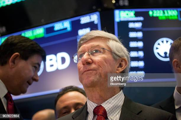 Vincent Forlenza chairman and chief executive officer of Becton Dickinson Co center stands on the floor of the New York Stock Exchange in New York US...