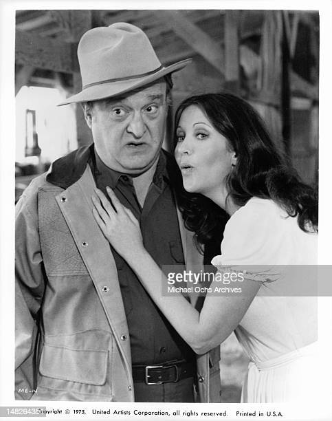 Vincent Gardenia looks to his right as Anjanette Comer leans into him in a scene from the film 'The Manchu Eagle Murder Caper Mystery' 1975