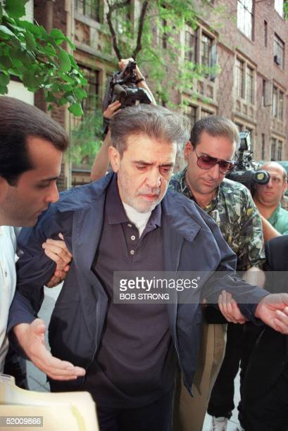 Vincent Gigante is helped to his limousine 26 June 1997 as he leaves a Manhattan townhouse on his way to Brooklyn Federal Court Gigante is being...