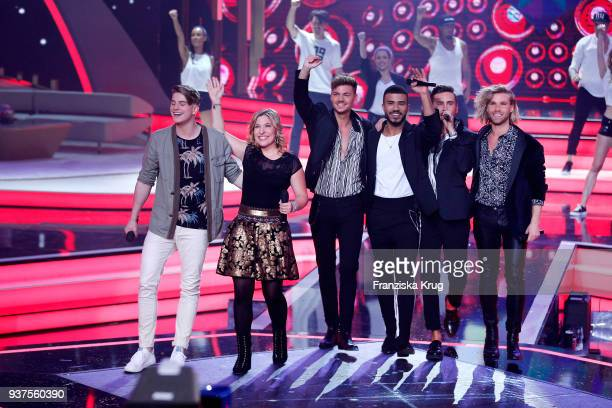 Vincent Gross Laura Wilde and the band Feuerherz perform during the tv show 'Willkommen bei Carmen Nebel' on March 24 2018 in Hof Germany The show...