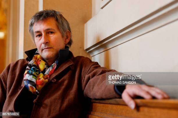 Vincent Guillot one of the founding members of the Intersex International Organization poses for a photograph in Paris on March 21 2017 / AFP PHOTO /...